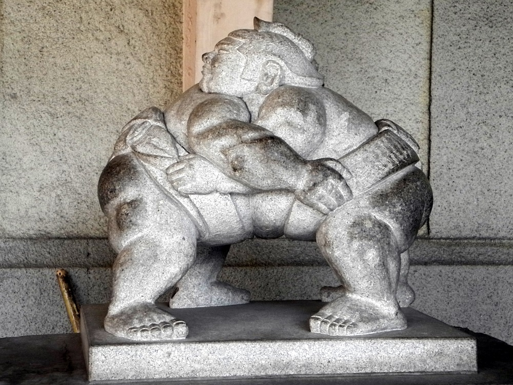 stone statue of sumo wrestlers The Real Japan Rob Dyer